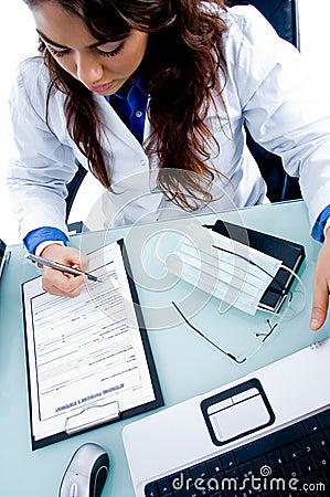 Female doctor writing prescription