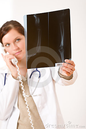 Female doctor with x-ray and phone