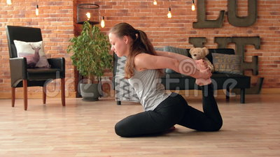 Female doing stretching workout stock footage