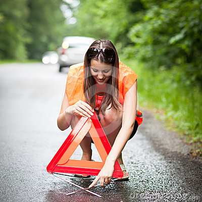Female driver after her car has broken down