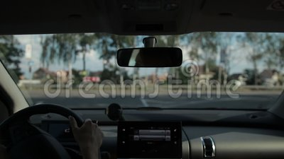 Female driver making a turn on highway stock video footage