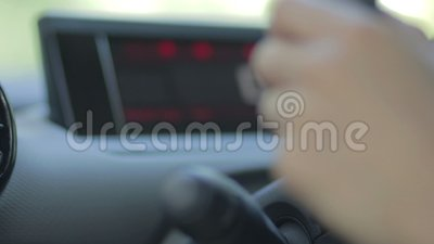 Female driver using turn signal switch stock video footage