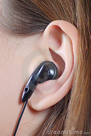 Female ear with an ear-phone