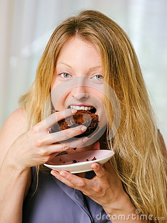 Female eating a brownie