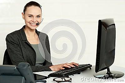 Female employee assisting customers