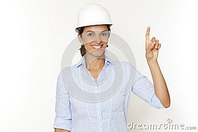 Female engineer pointing on virtual screen