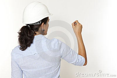 Female engineer writing