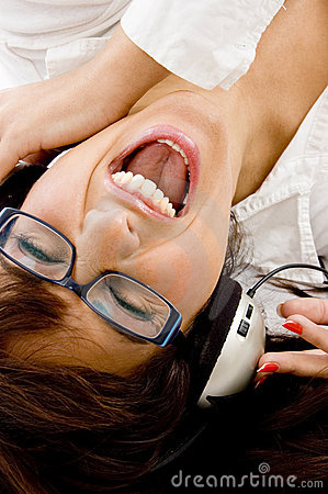 Female enjoying music with headphones