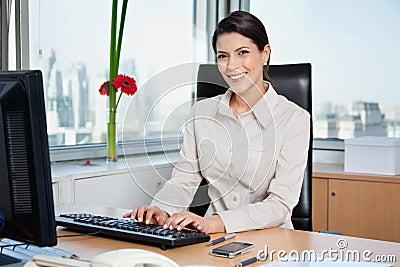 Female Entrepreneur Working On Computer