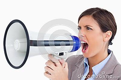 Female entrepreneur yelling through megaphone
