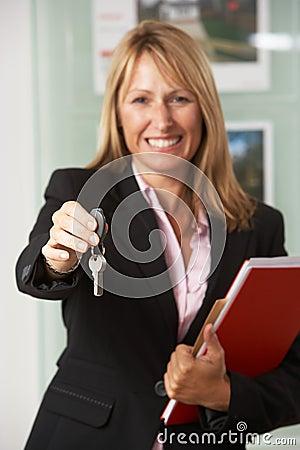 Female Estate Agent Handing Over Keys