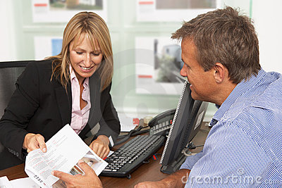 Female Estate Discussing Property Details