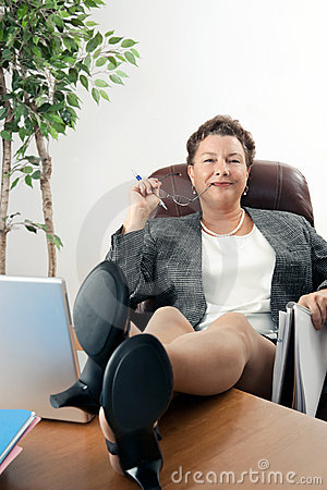 Female Executive with Feet on Desk