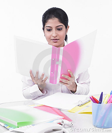 Female executive looking at a file