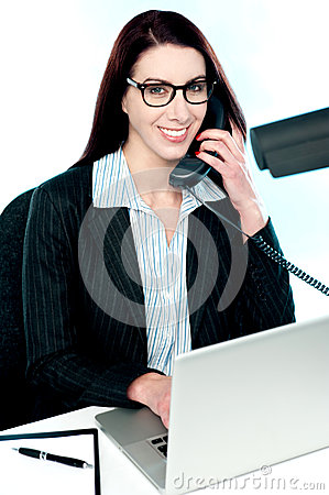Female executive speaking on phone