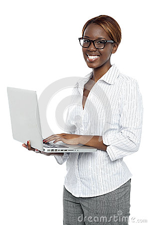 Female executive typing on laptop and working