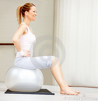 Female exercising on a fitness ball