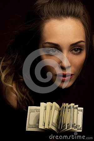 Female face with fan of dollars