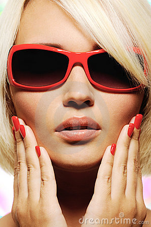 Female face in fashion red sunglasses