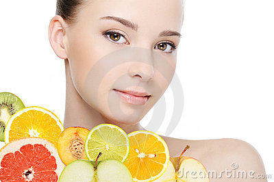 Female face with fresh fruits