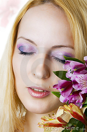 Female face with healthy skin and flowers