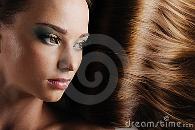Female face with luxuriant long hair