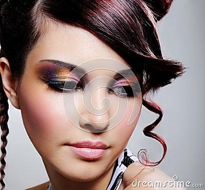 Female face with multicoloured eyeshadow