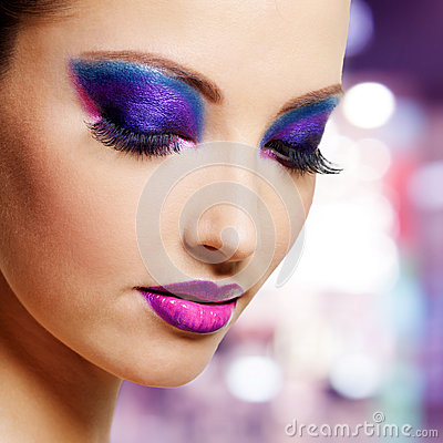 Female face with purple fashion makeup