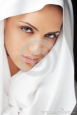 Female face white veil