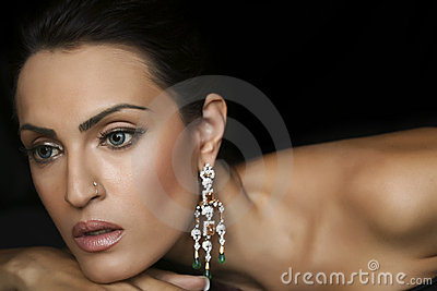 Female fashion model wearing jewelery