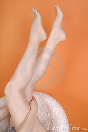Female Feet In An Armchair Royalty Free Stock Photos - Image: 8170698