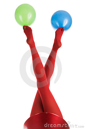 Female feet in red stockings with balloons