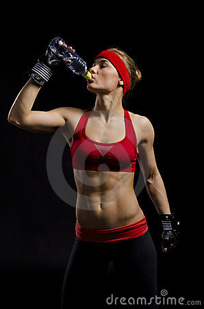 Female fighter drinking
