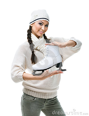 Female figure skater hands one skate