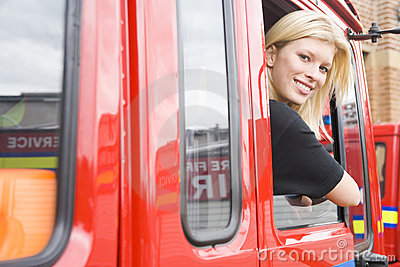 Female firefighter sitting in the cab