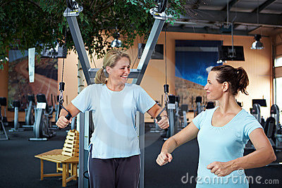 Female fitness coach helping