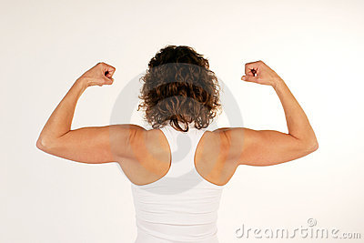Female fitness instructor flexing arm muscles