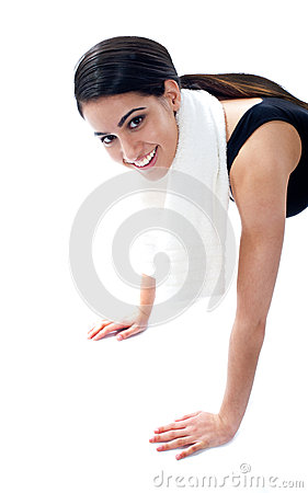 Female fitness trainer doing push ups