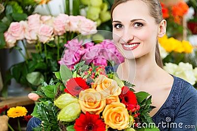 Female florist in flower shop