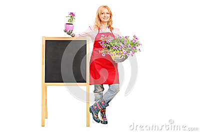 Female florist holding flowers and posing