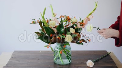 Female Florist Puts Flowers In A Glass Vase And Making A New Floral Arrangements. Woman Picking Fresh Flowers From Box Stock Video - Video of arrangement ... & Female Florist Puts Flowers In A Glass Vase And Making A New Floral ...