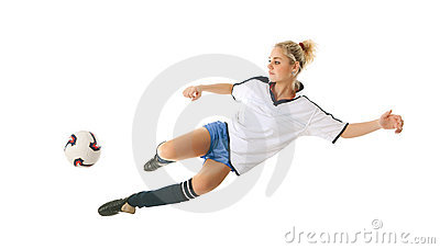 Female football player in the jump-kicks the ball