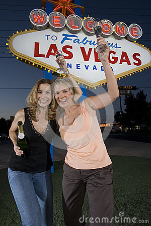 Female Friends With Champagne Against  Welcome To Las Vegas  Sign