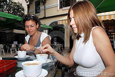 Female friends enjoying a cup of coffe