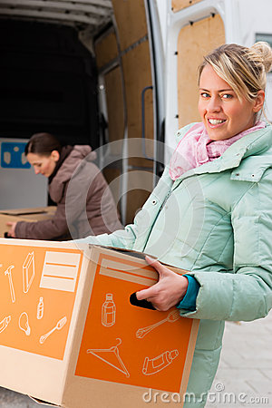 Free Female Friends Loading A Moving Truck Royalty Free Stock Images - 27039369