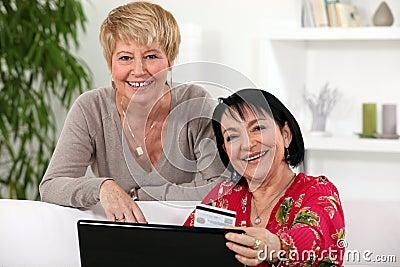 Female friends shopping online.
