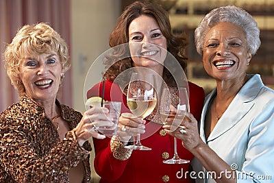 Female Friends Socializing At A Bar
