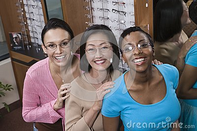 Female Friends Trying On Glasses At Optometrist