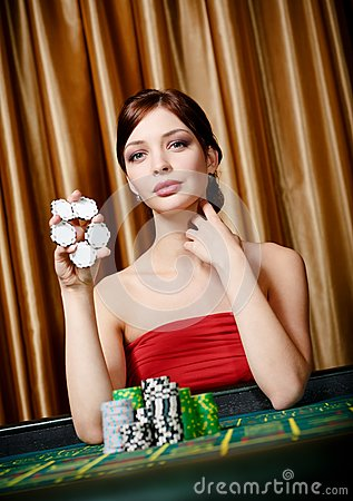Female gambler keeps chips in hand