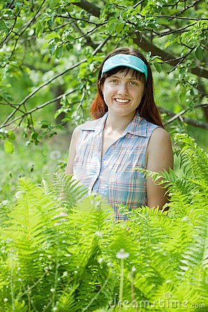 Female gardener in fern plant